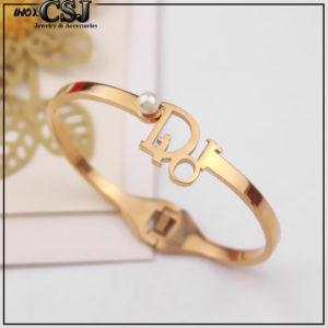 Vòng tay titan Dior vàng hồng