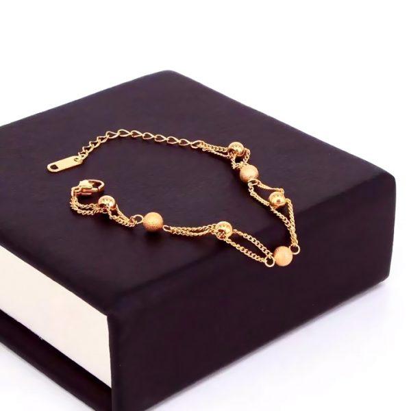 Lắc tay titan thời trang bi mạ vàng